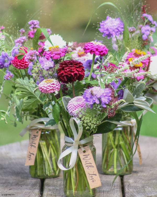 3 jam jars packed with summer flowers
